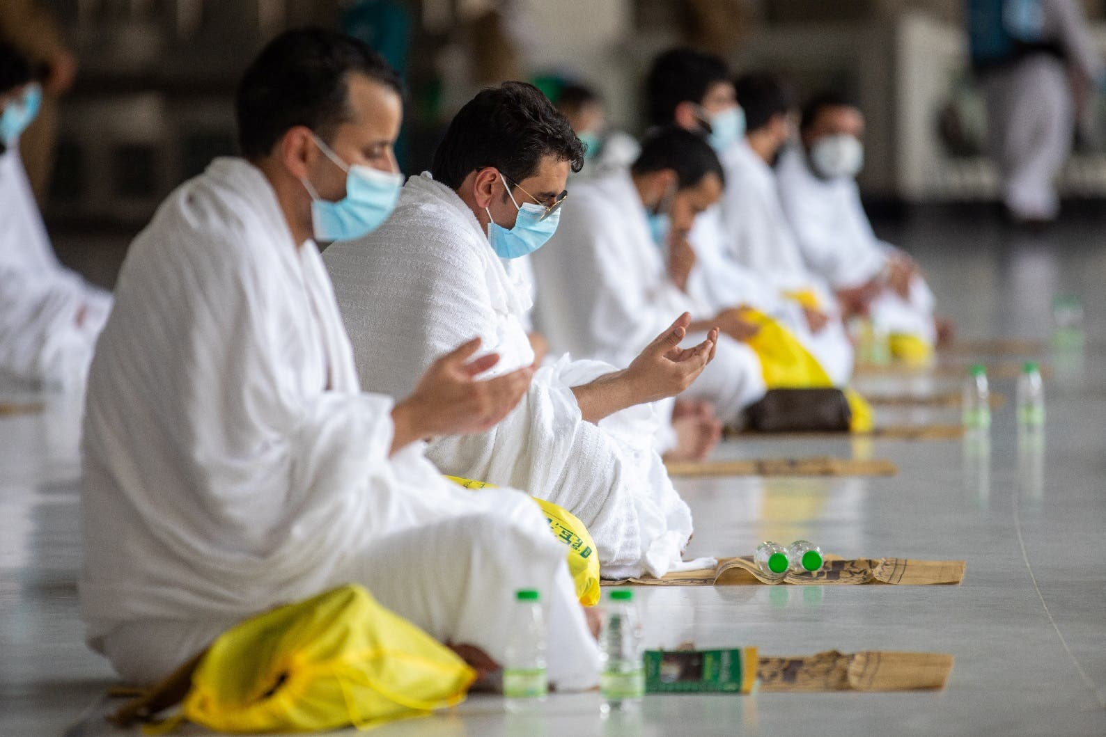 Muslim pilgrims wearing protective face masks pray at the Grand mosque during the annual Haj pilgrimage amid the coronavirus pandemic, in the holy city of Mecca, Saudi Arabia, July 29, 2020. (SPA via Reuters)