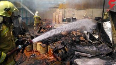 حريق يلتهم منطقة تجارية كبيرة في طهران