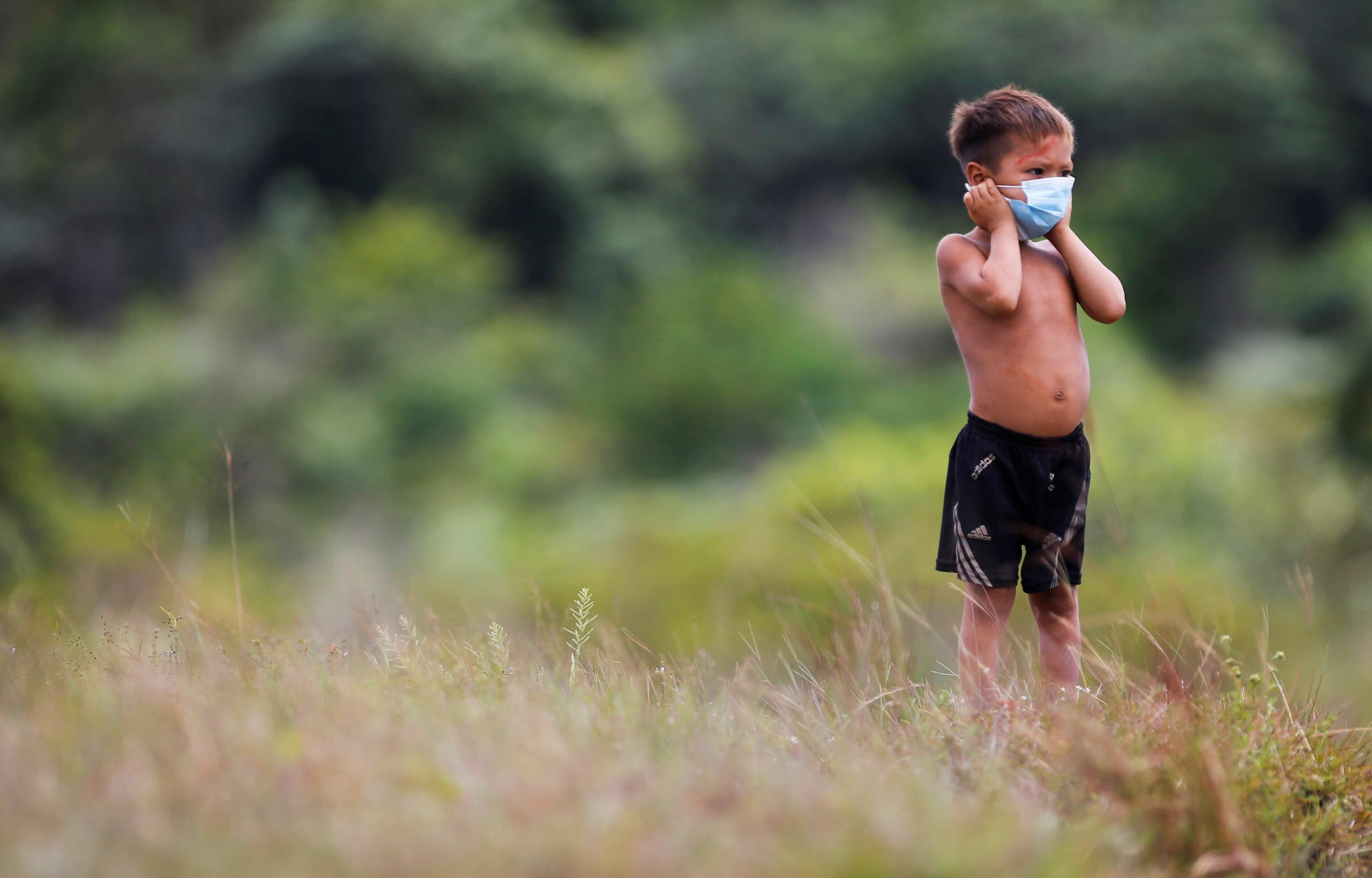 An Indigenous child from Yanomami ethnic group is seen, amid the spread of the coronavirus disease (COVID-19), at the 4th Surucucu Special Frontier Platoon of the Brazilian army in the municipality of Alto Alegre, state of Roraima, Brazil July 1, 2020. (Reuters)