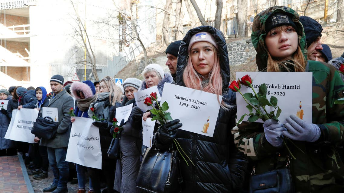 FILE PHOTO: People hold posters with names of victims of the Ukraine International Airlines flight 752 plane disaster during a commemoration ceremony in front of the Iranian embassy in Kiev, Ukraine February 17, 2020. REUTERS/Valentyn Ogirenko/File Photo