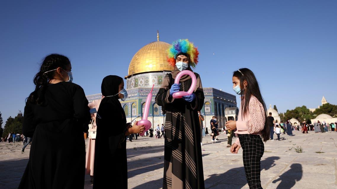 Palestinians celebrate Eid al-Adha holiday under virus restrictions in Jerusalem. (Reuters)
