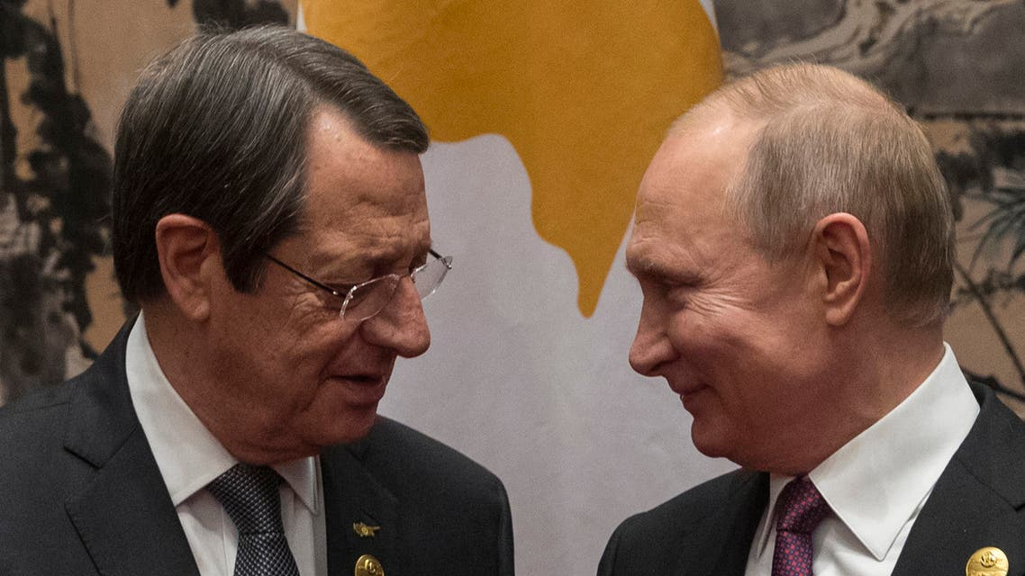 Russia's President Vladimir Putin (R) welcomes Cyprus President Nicos Anastasiades (L) at the start of their meeting on the sidelines of the Belt and Road Forum in Beijing on April 26, 2019.