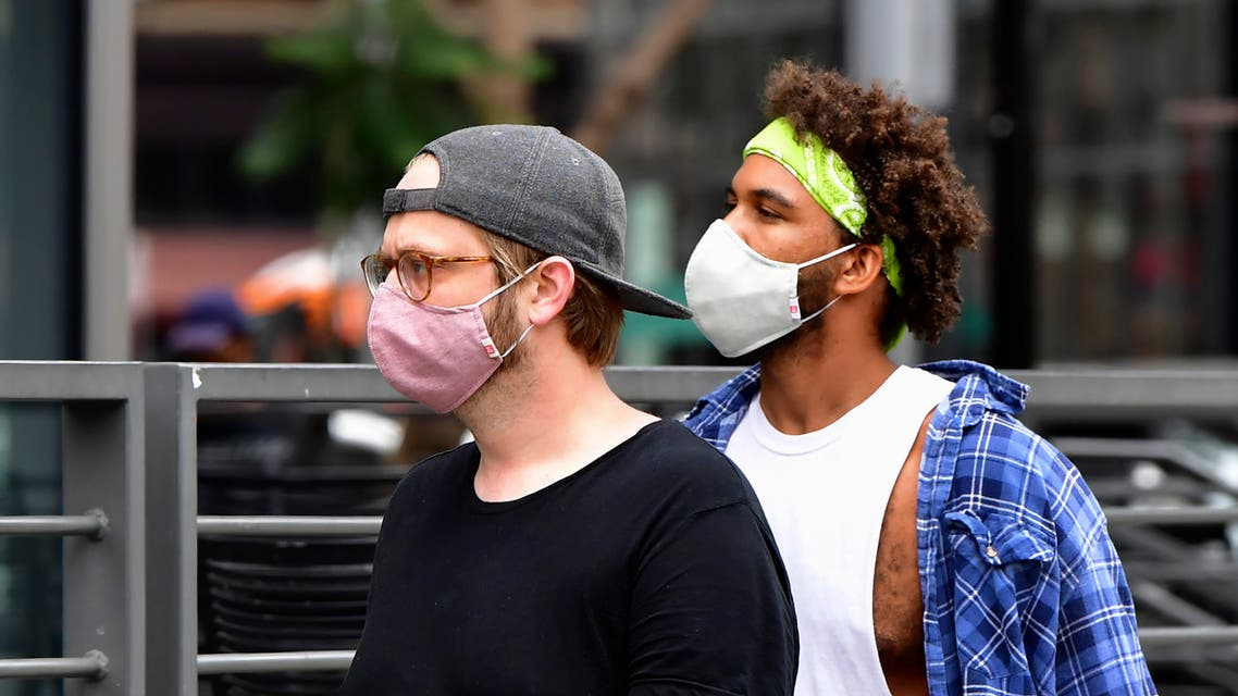 Young men wearing facemasks due to the coronavirus pandemic are seen in Los Angeles on June 29, 2020 where the largest single-day number of new COVID-19 cases in the county since the pandemic began was confirmed, with a spike among the younger population. The coronavirus pandemic is not even close to being over, the WHO warned today, as the global death toll passed half a million and cases surge in Latin America and the United States.