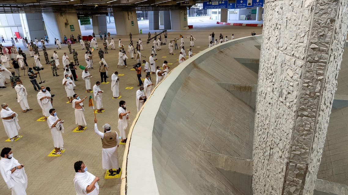 Muslim pilgrims, keeping social distance and wearing face masks, cast stones at pillars symbolizing Satan during the annual Haj pilgrimage amid the coronavirus disease (COVID-19) pandemic, in Mina, near the holy city of Mecca. (Reuters)