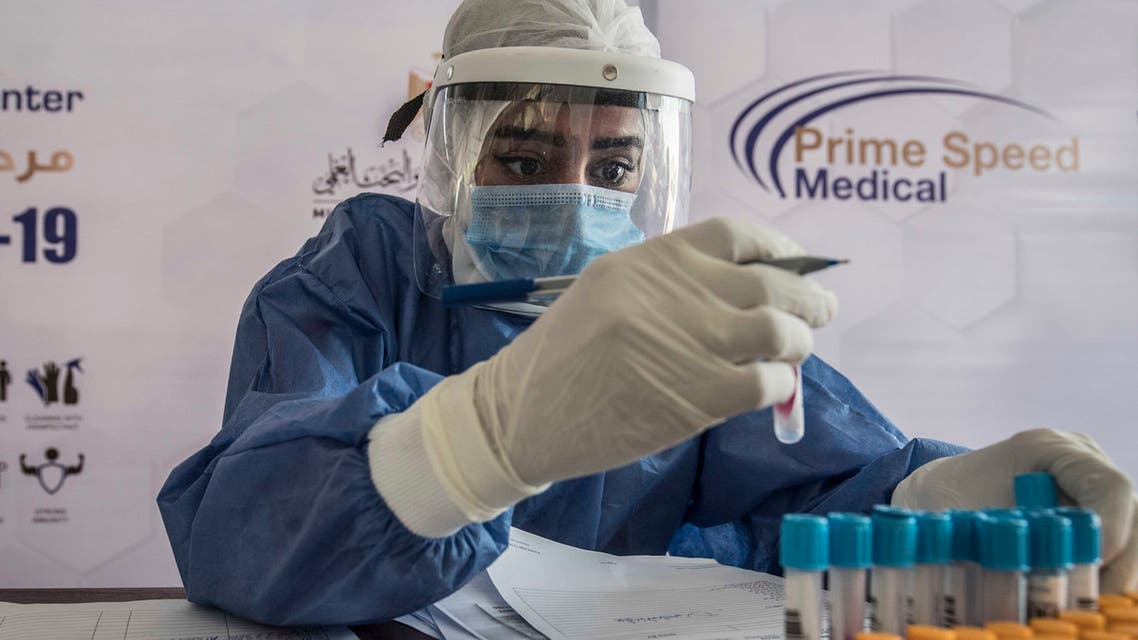 An Egyptian health worker checks samples at a drive-through coronavirus-testing center at the Ain Shams University in Cairo on June 29, 2020. Egypt has so far registered 65,188 COVID-19 cases including 2,789 fatalities.