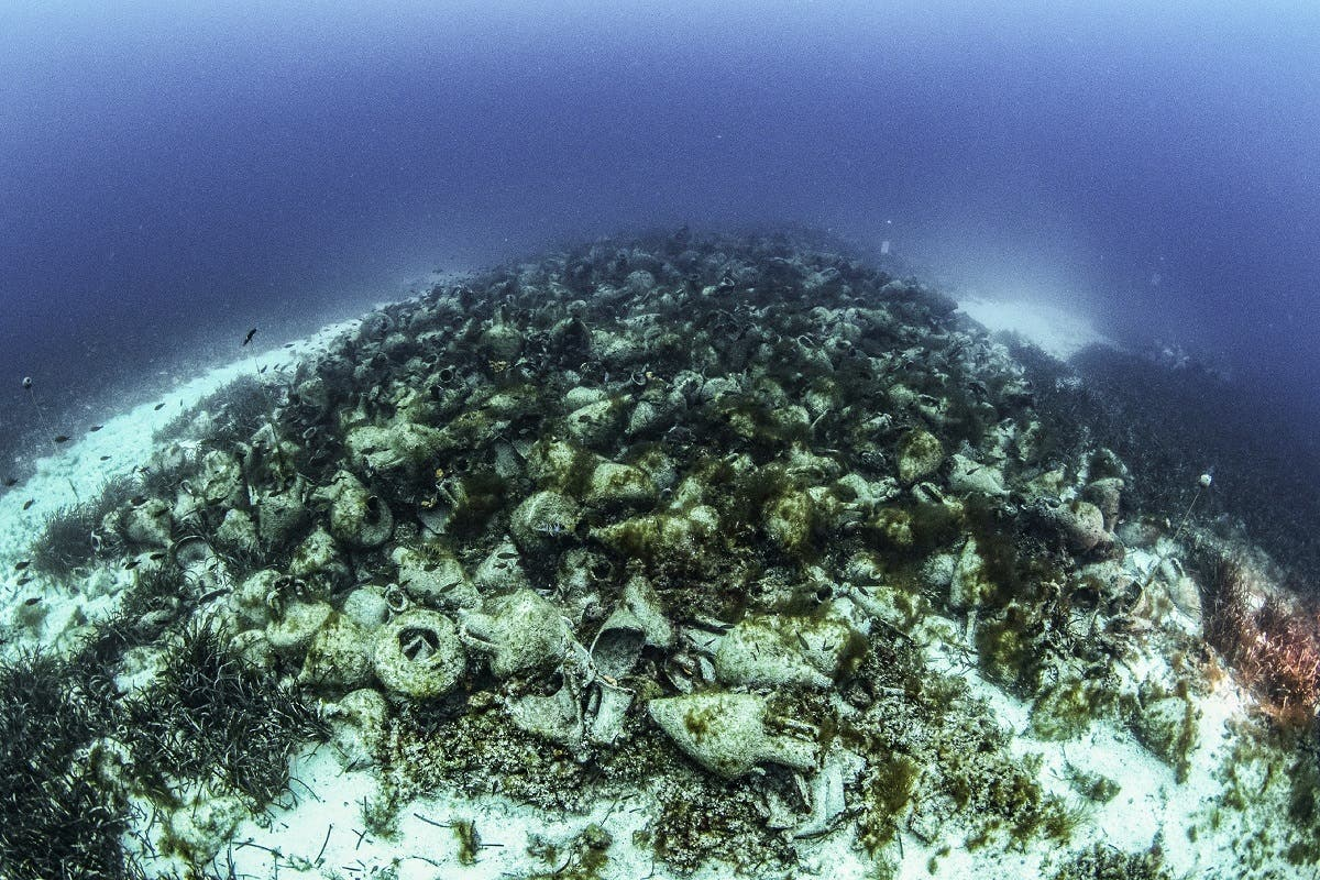 This undated handout photo taken and released by the Ephorate of Underwater Antiquities on April 9, 2019 shows an underwater view of the ruins of an ancient shipwreck on the Aegean island of Alonissos, Greece. (AFP)
