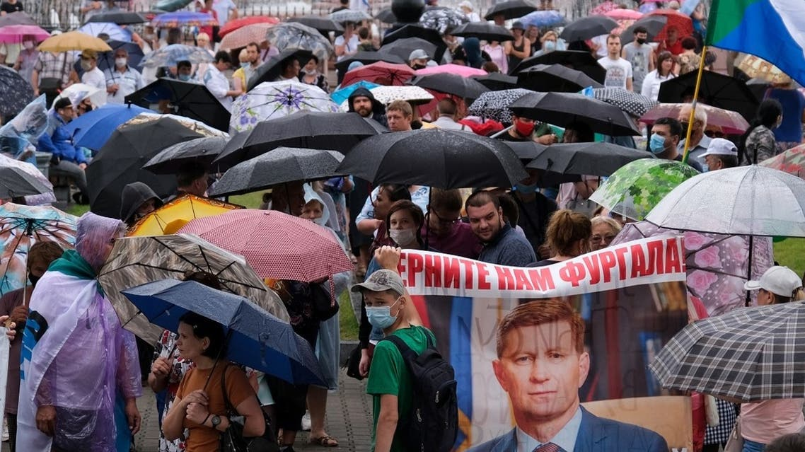 People carry a banner reading Return Furgal for us, during an unauthorised rally in support of Sergei Furgal in the Russian far eastern city of Khabarovsk on August 1, 2020. (AFP)