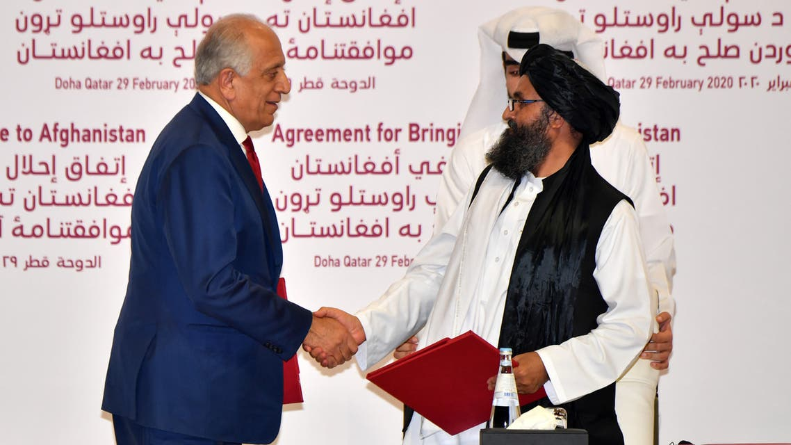 (L to R) US Special Representative for Afghanistan Reconciliation Zalmay Khalilzad and Taliban co-founder Mullah Abdul Ghani Baradar shake hands after signing a peace agreement during a ceremony in the Qatari capital Doha on February 29, 2020 The United States signed a landmark deal with the Taliban, laying out a timetable for a full troop withdrawal from Afghanistan within 14 months as it seeks an exit from its longest-ever war.