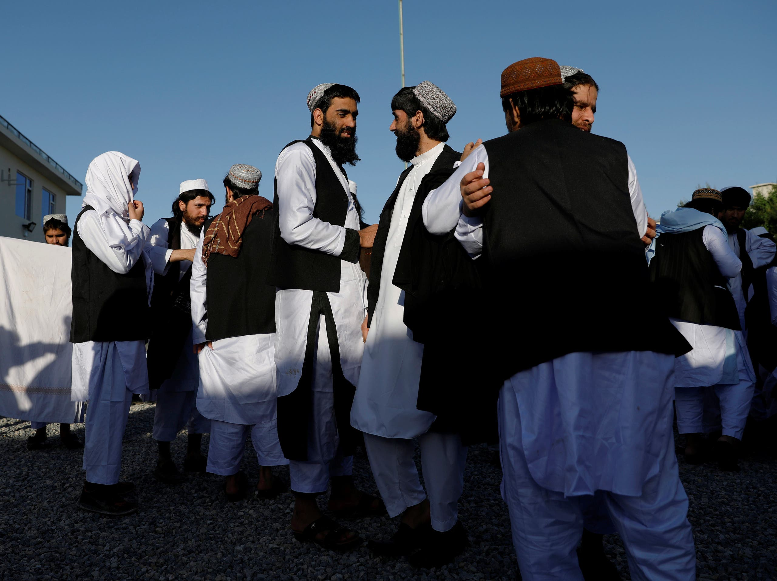 Newly freed Taliban prisoners greet each other at Pul-i-Charkhi prison, in Kabul, Afghanistan May 26, 2020. (Reuters)