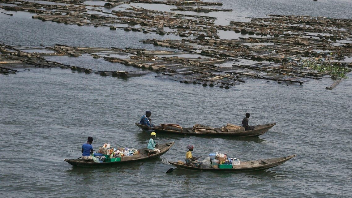 Women on canoes sells snacks and bottled water on the Lagoon, in Lagos Nigeria, Wednesday May 20, 2020. (AP)