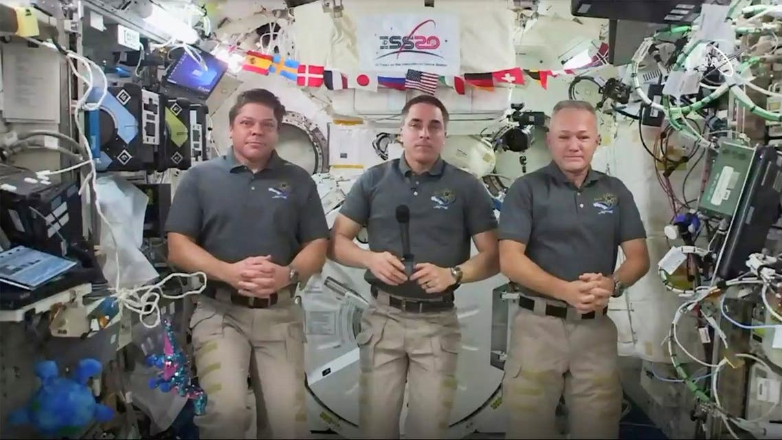 This photo provided by NASA shows from left, astronauts Bob Behnken, Chris Cassidy and Doug Hurley during an interview on the International Space Station on Friday, July 31, 2020. (AP)