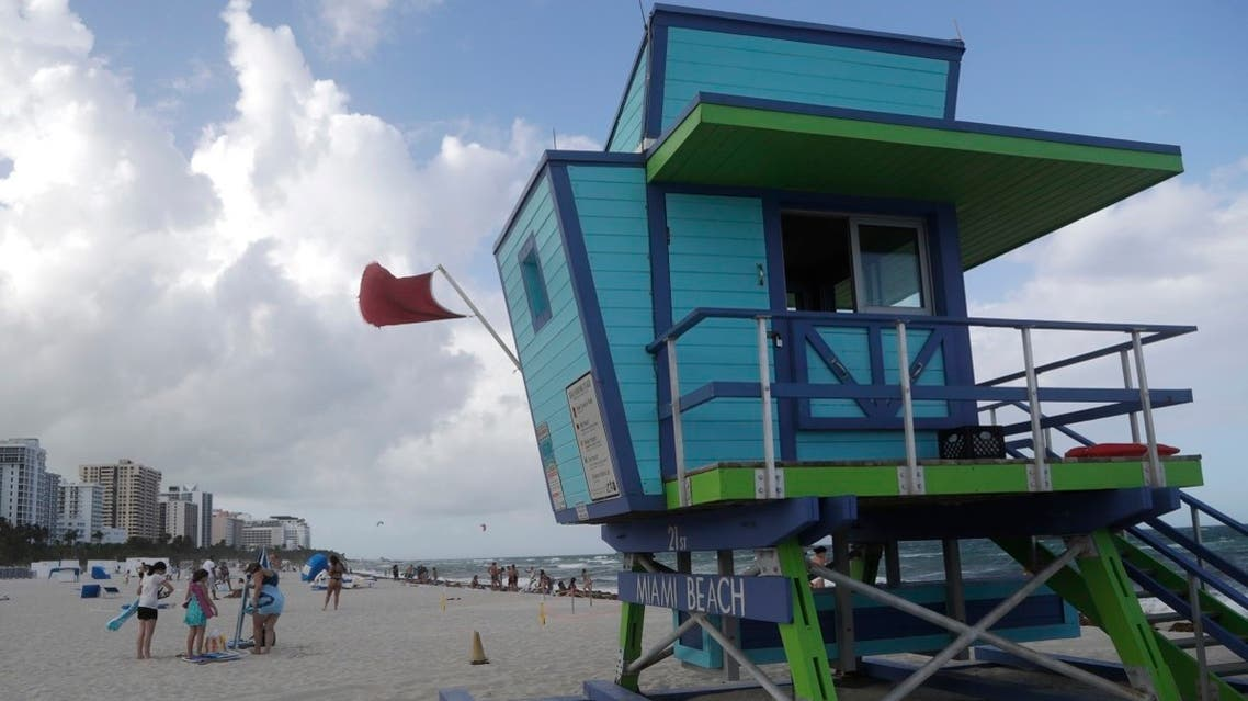 A red flag flies from a lifeguard station indicating high surf, Friday, July 31, 2020, in Miami Beach, Florida, US. (AP)