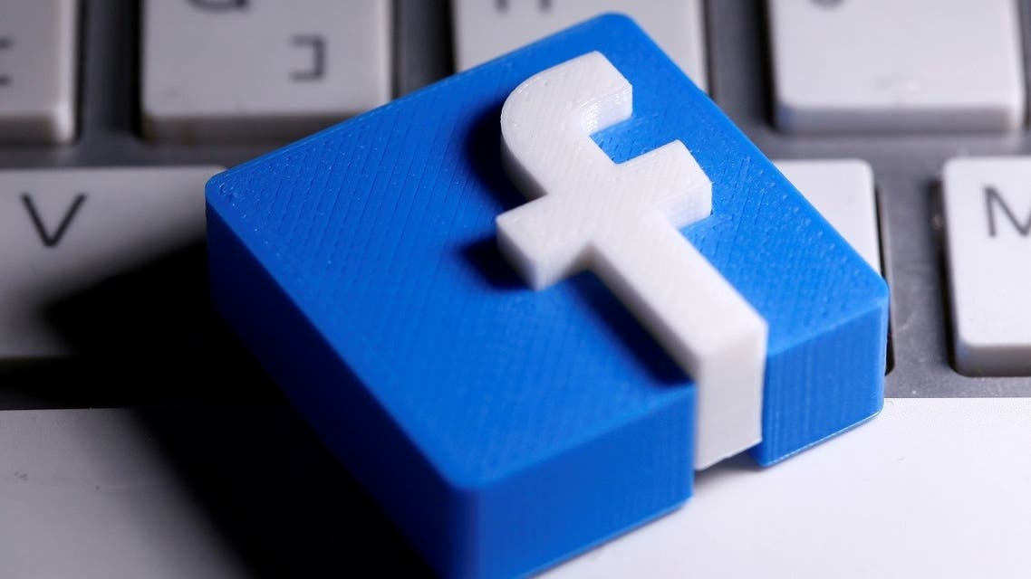 A 3D-printed Facebook logo is seen placed on a keyboard in this illustration taken March 25, 2020. (Reuters)