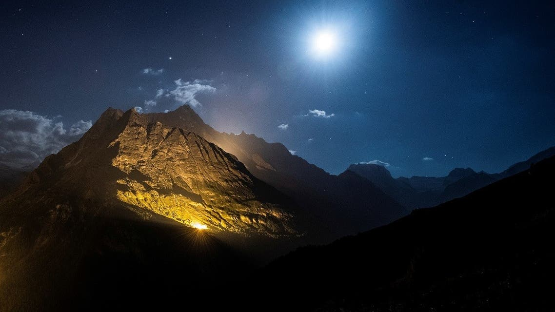The mountain chains of Veisivi and Dent de Perroc are illuminated by 100 kg of the magnesium powder to celebrate Swiss National Day following the coronavirus disease (COVID-19) outbreak in Ferpecle near Evolene in the Val d'Herens, Switzerland July 31, 2020. (Reuters)
