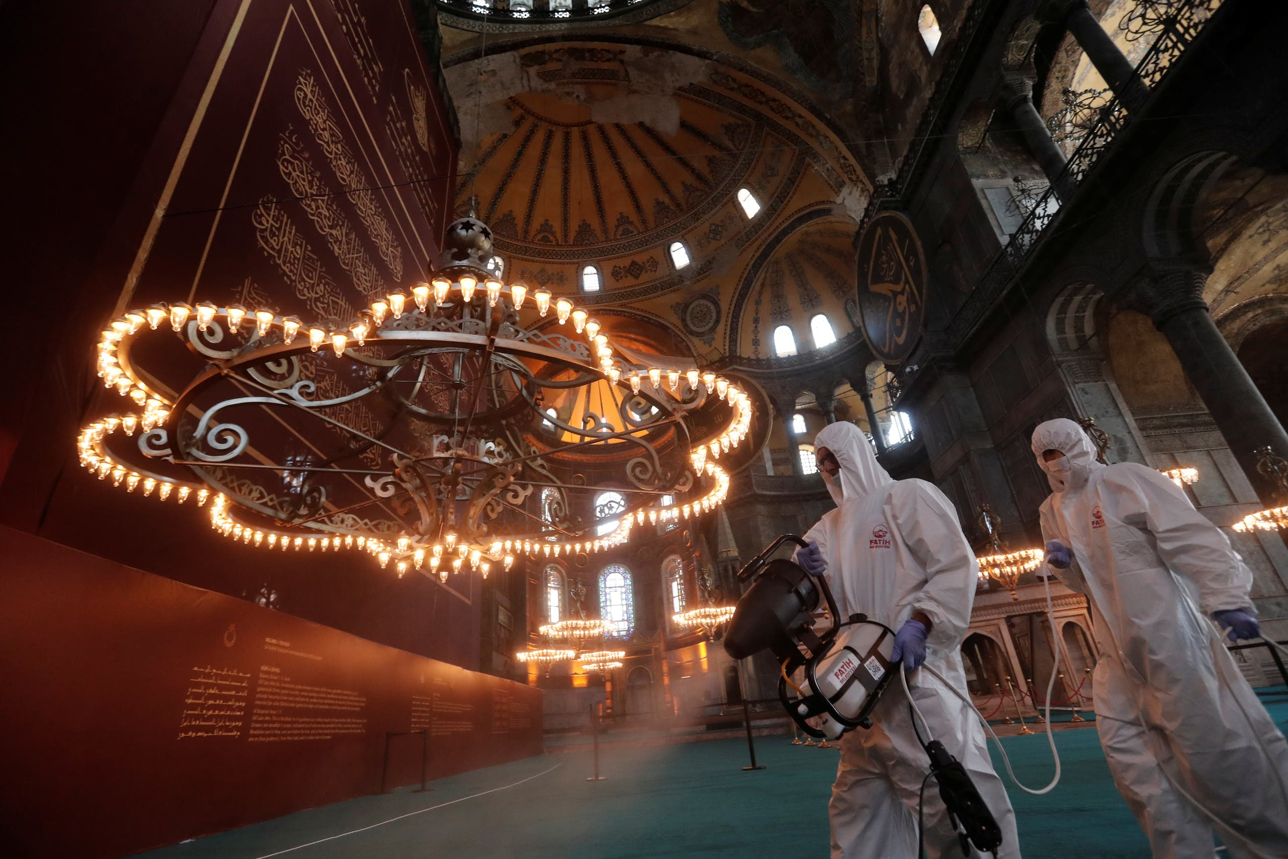 Fatih Municipality workers in protective suits disinfect Hagia Sophia Grand Mosque on the eve of the Muslim festival of Eid al-Adha, to prevent the spread of the coronavirus disease (COVID-19), in Istanbul, Turkey, July 30, 2020. (Reuters)