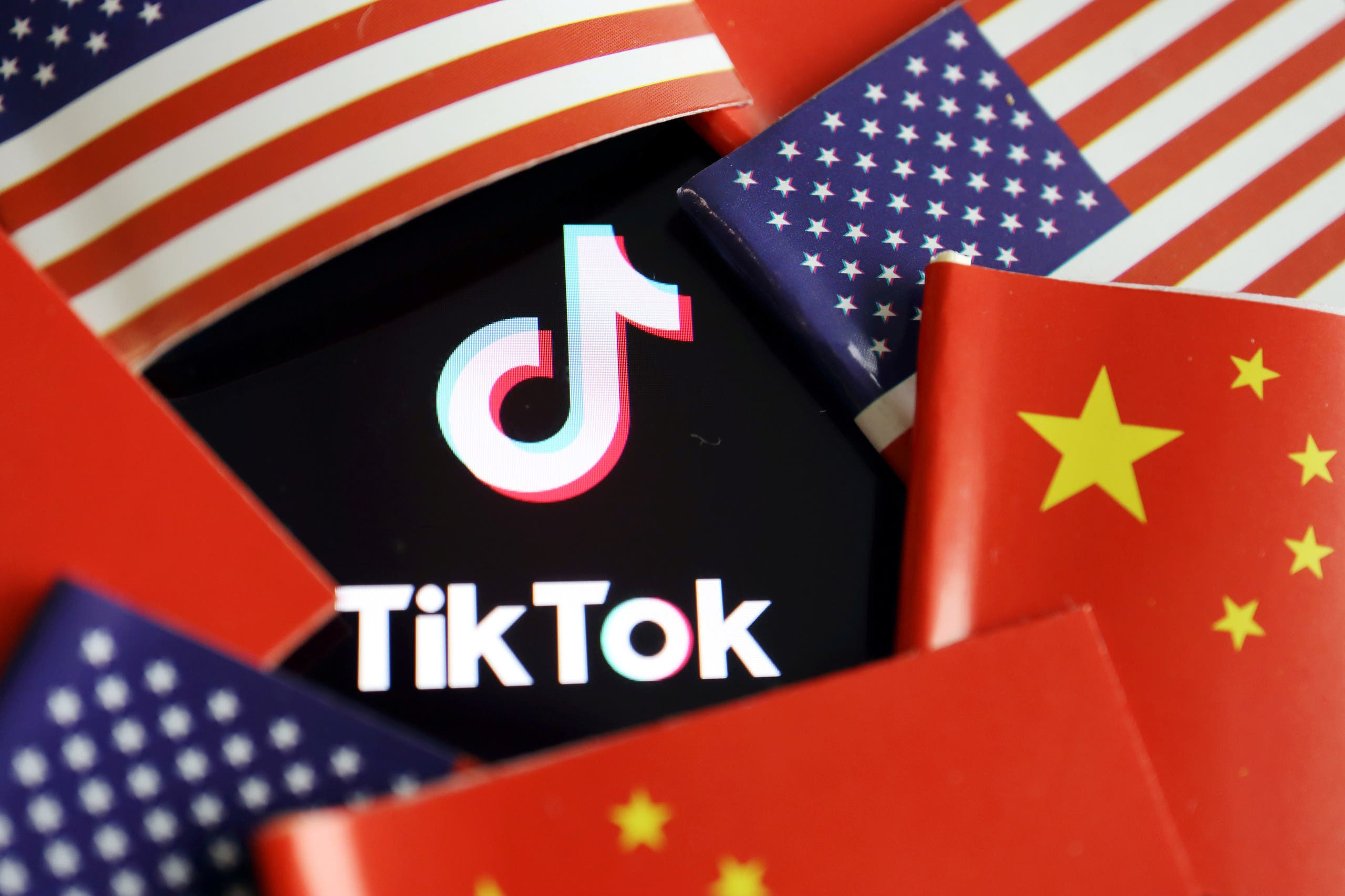 China and US flags are seen near a TikTok logo in this illustration picture taken July 16, 2020. (Reuters/Florence Lo)