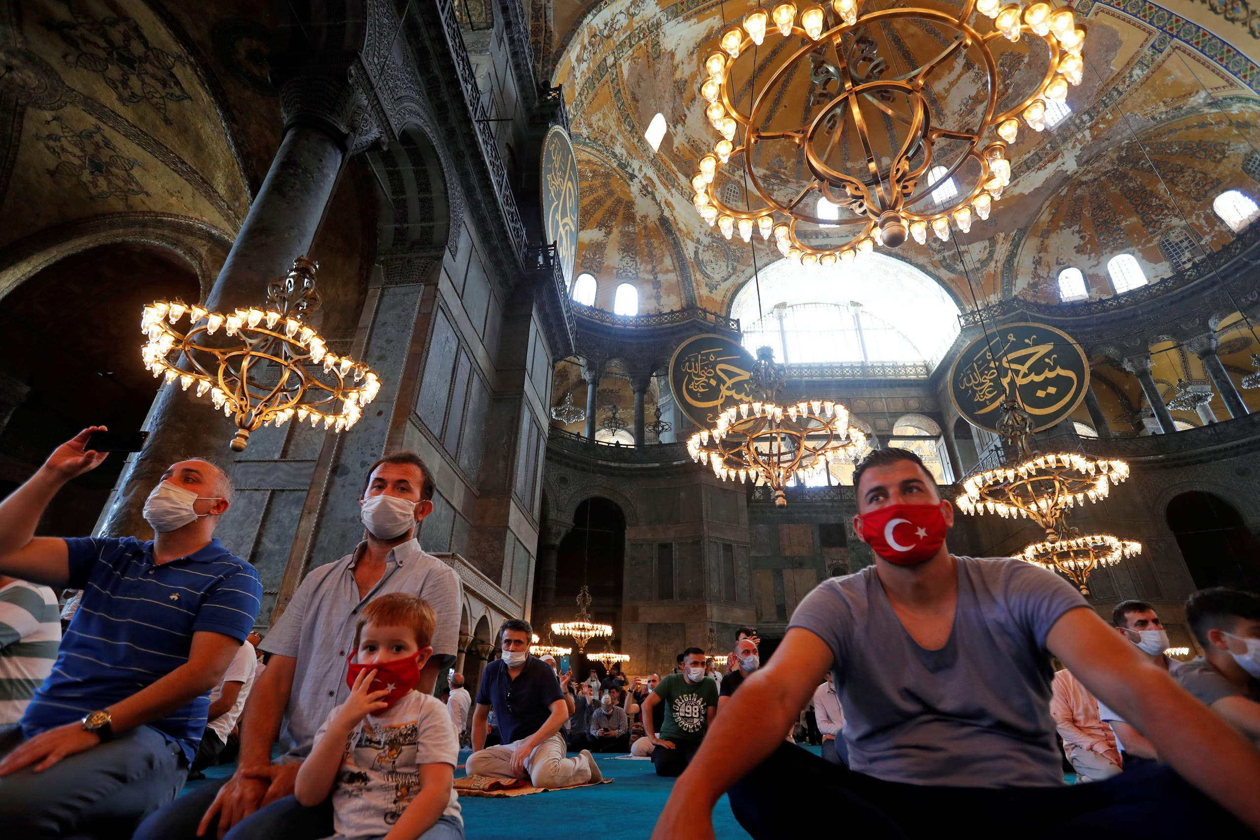 Worshippers attend the afternoon prayer at Hagia Sophia Grand Mosque in Istanbul, Turkey, July 26, 2020. (Reuters)