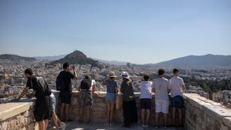 Greece formally opens borders to tourists