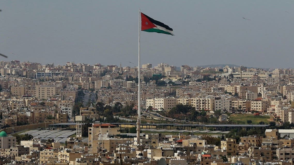 A picture taken on April 27, 2020, shows the Jordanian flying waving in the wind over the capital Amman. (AFP)
