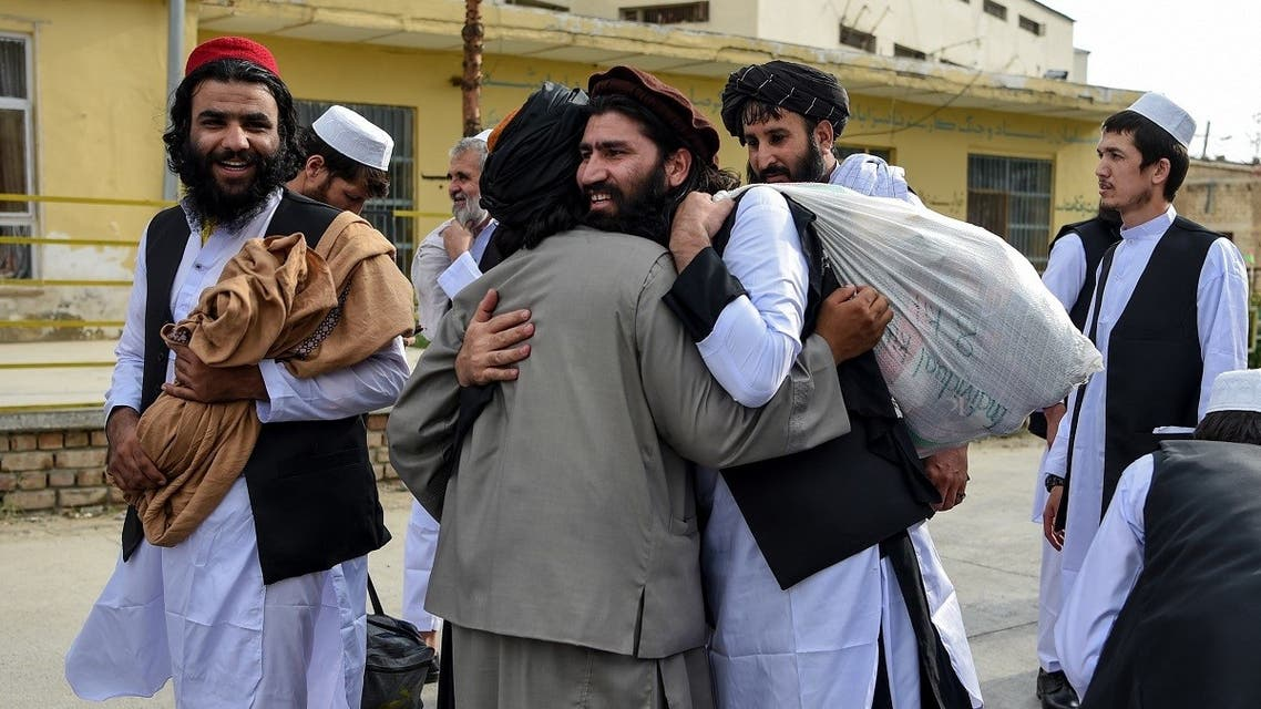 Taliban prisoners great each other as they are in the process of being potentially released from Pul-e-Charkhi prison, on the outskirts of Kabul on July 31, 2020. (AFP)