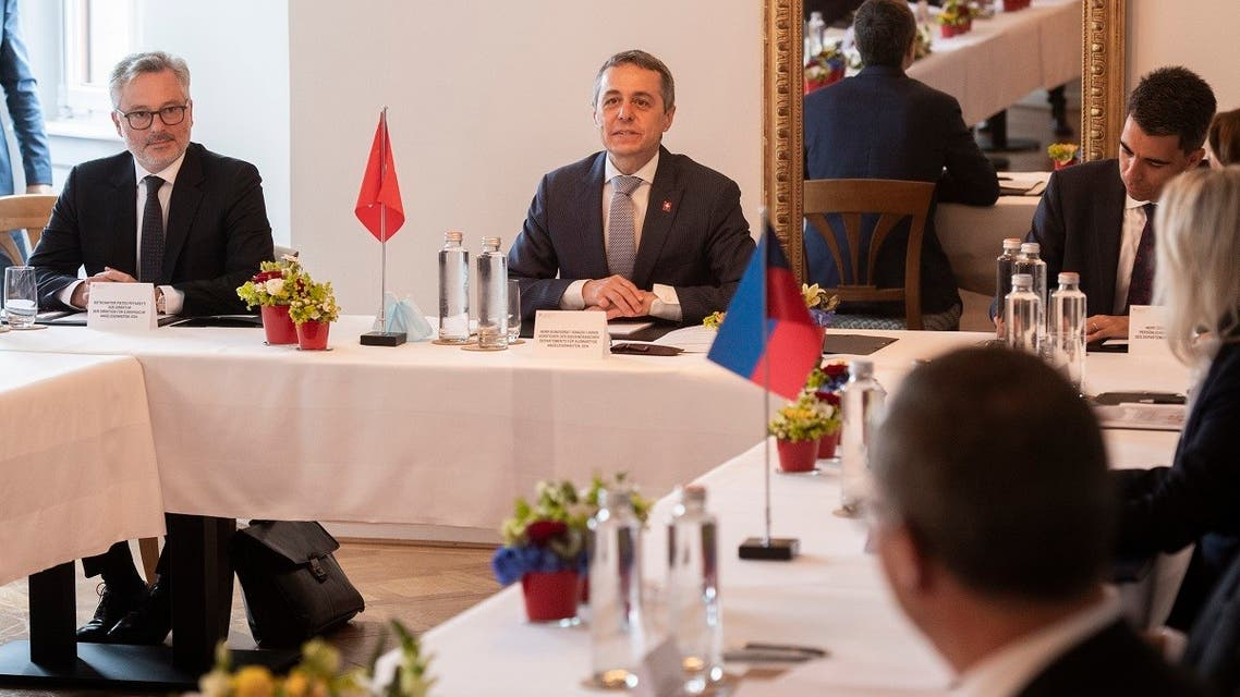 Ignazio Cassis (C), Federal Councillor and Minister of Foreign Affairs of Switzerland, sits during a meeting between the Ministers of Foreign Affairs of Switzerland, Austria, Liechtenstein, Baden-Wuerttemberg and the International Committee of Lake Constance, regarding the re-opening of borders amid the coronavirus COVID-19 crisis, on June 17, 2020, in Kreuzlingen, Switzerland. (AFP)