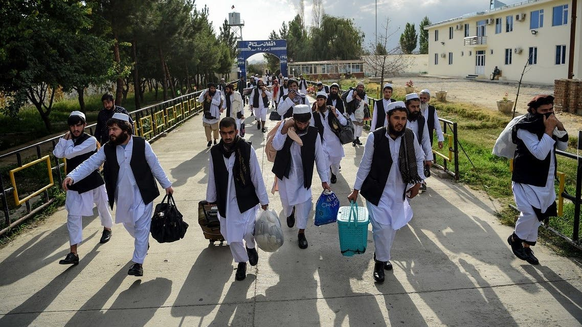 Taliban prisoners walk as they are in the process of being potentially released from Pul-e-Charkhi prison, on the outskirts of Kabul on July 31, 2020. (AFP)