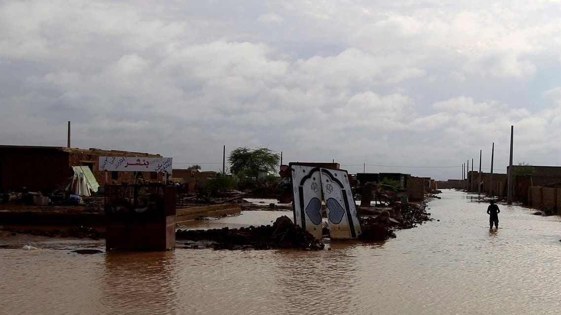 A man walks past the remains of a house destroyed by the floods caused by heavy rains in Khartoum August 6, 2013.  (Reuters)