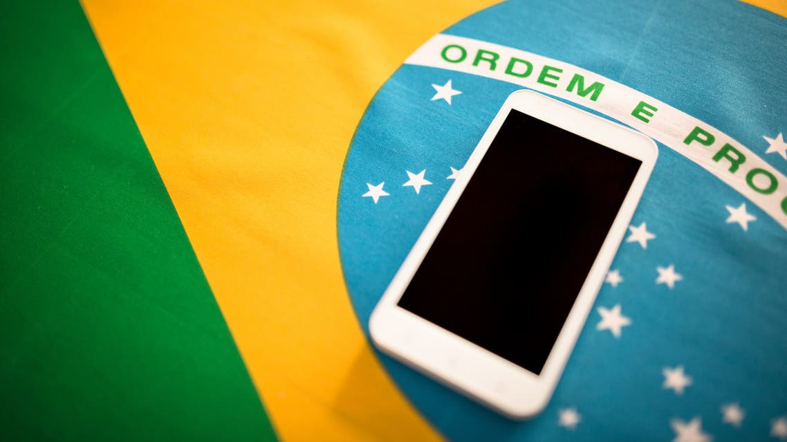 Brazilian flag background with smartphone stock photo