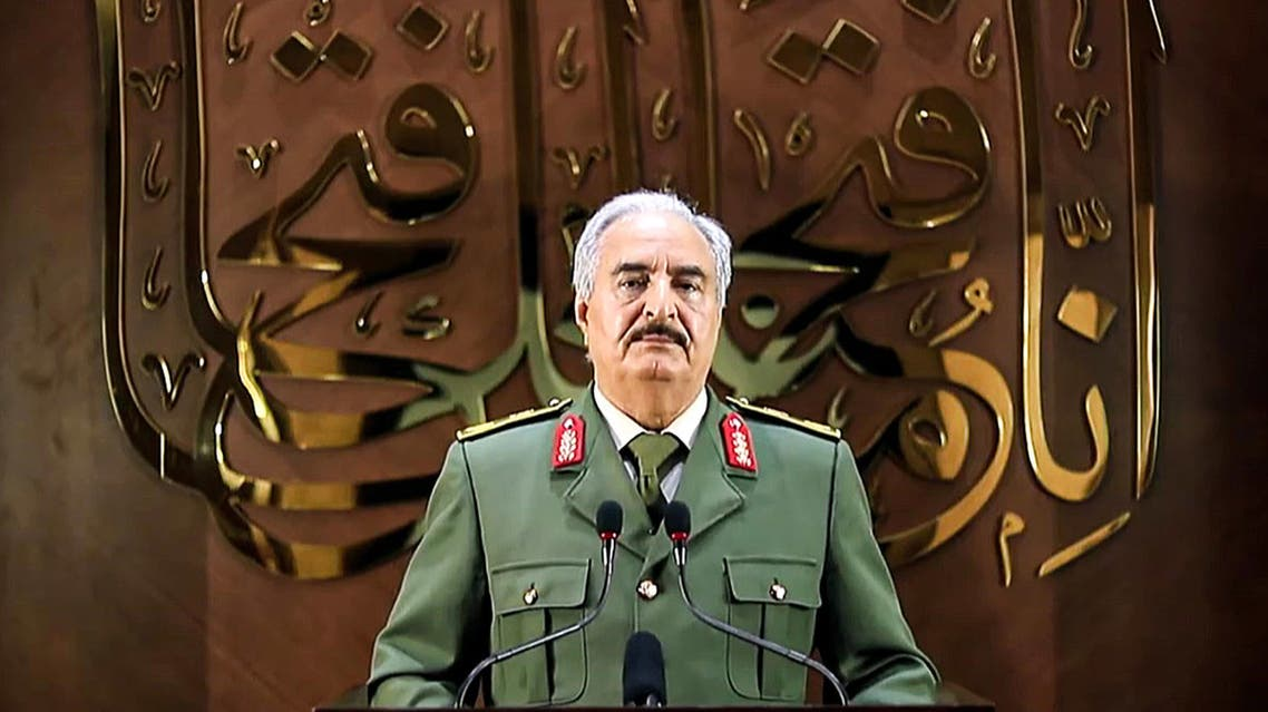 This image grab taken from a video published by the War Information Division of military strongman Khalifa Haftar's self-proclaimed Libyan National Army (LNA) on April 28, 2020 shows Haftar giving a speech, saying he had a popular mandate to govern the country, declaring a key 2015 political deal over and vowing to press his assault to seize Tripoli. In a speech on his Libya al-Hadath TV channel, Haftar said his self-styled Libyan army was proud to be mandated with the historic task of leading Libya. He did not make clear whether an elected parliament in the country's east, a signatory to the deal, backed his move -- or what its future role would be. Haftar has so far drawn his legitimacy from the administration based in the country's east, and last April his forces launched an assault to seize the capital Tripoli, in the west, from the Government of National Accord.