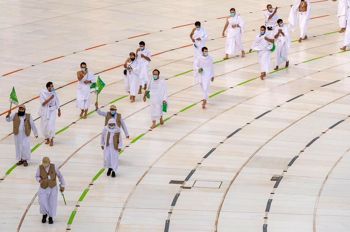 Muslim pilgrims wearing face masks and keeping social distance perform Tawaf around Kaaba during the annual Haj pilgrimage. (Reuters)