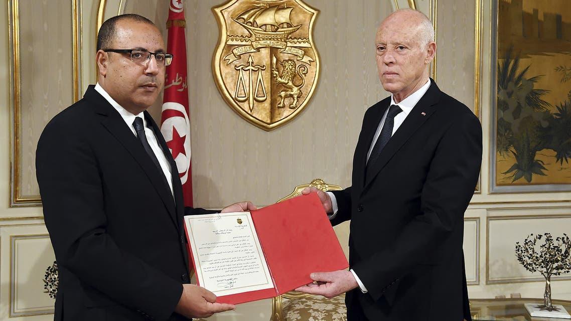 الرئيس التونسي مكلفا هشام المشيشي تشكيل الحكومة (أرشيفية- فرانس برس)
