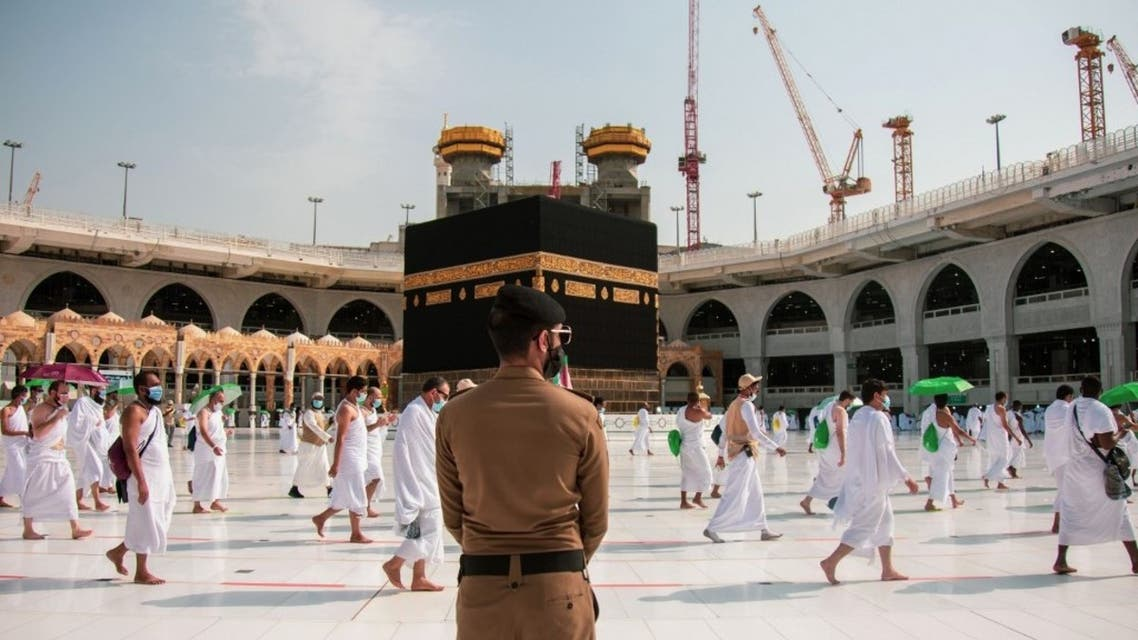 A handout picture provided by Saudi Ministry of Media on July 31, 2020 shows pilgrims circumambulating around the Kaaba, the holiest shrine in the Grand mosque in the holy Saudi city of Mecca. (AFP)