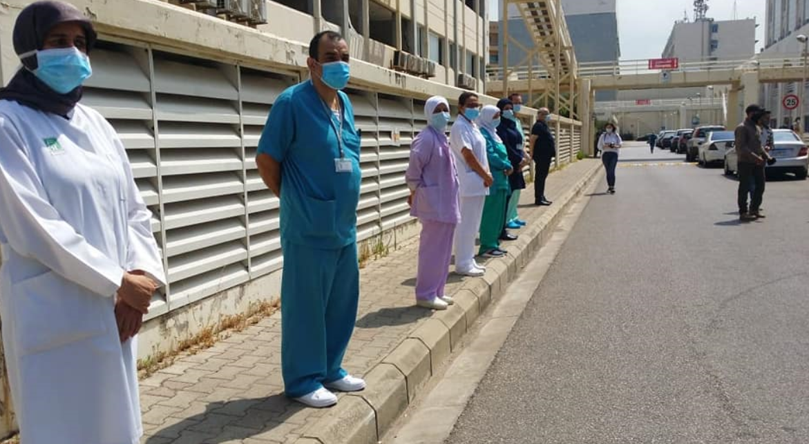 Medical workers in a moment of farewell to Zainab Haider at Rafik Hariri University Hospital in Beirut. (Twitter)