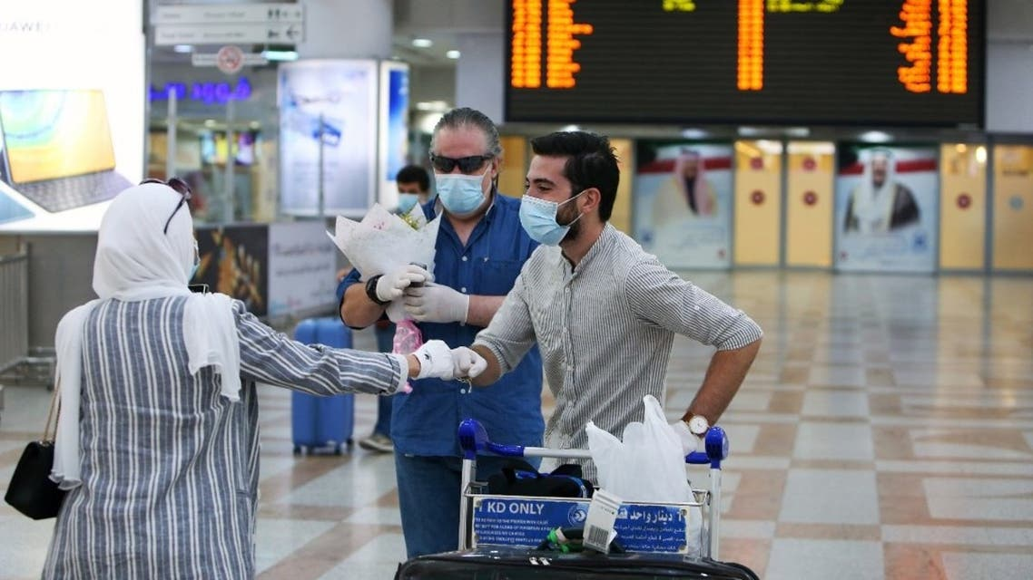 Travellers arrive at Kuwait international Airport, in Farwaniya, about 15kms south of Kuwait City, on August 1, 2020. (AFP)