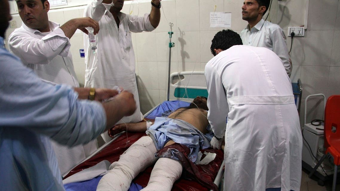 A wounded man receives treatment at a hospital after a suicide car bomb and multiple gunmen attack in the city of Jalalabad, east of Kabul, Afghanistan, Sunday, August 2, 2020. (AP)