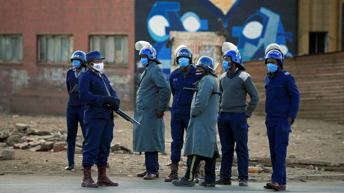 Police officers patrol the street ahead of planned anti-government protests during the coronavirus disease (COVID-19) outbreak in Harare, Zimbabwe, July 31, 2020. (Reuters)