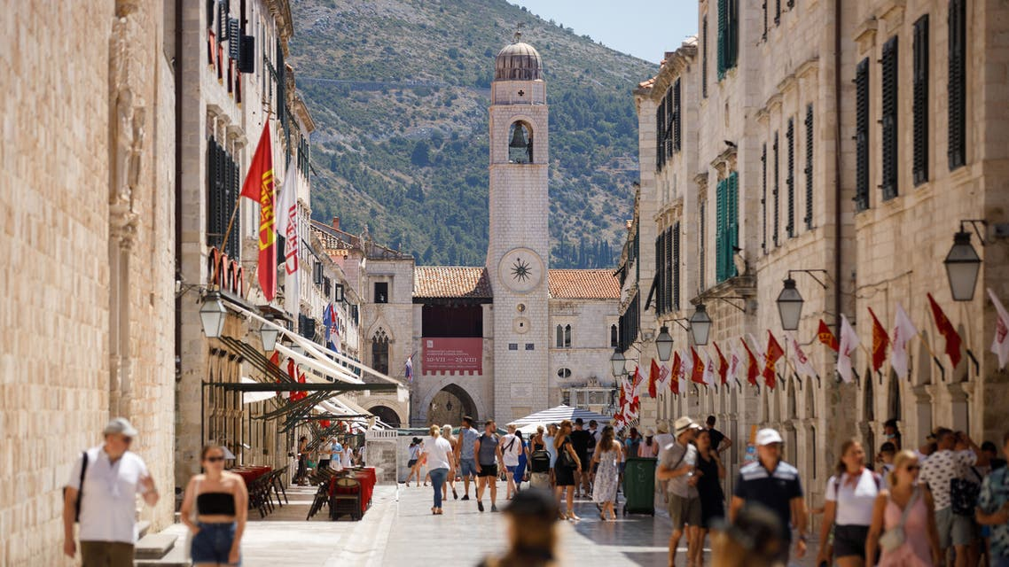 Tourists are seen at Stradun street in Dubrovnik, amid the spread of the coronavirus disease (COVID-19), Croatia, July 28, 2020. (Reuters)