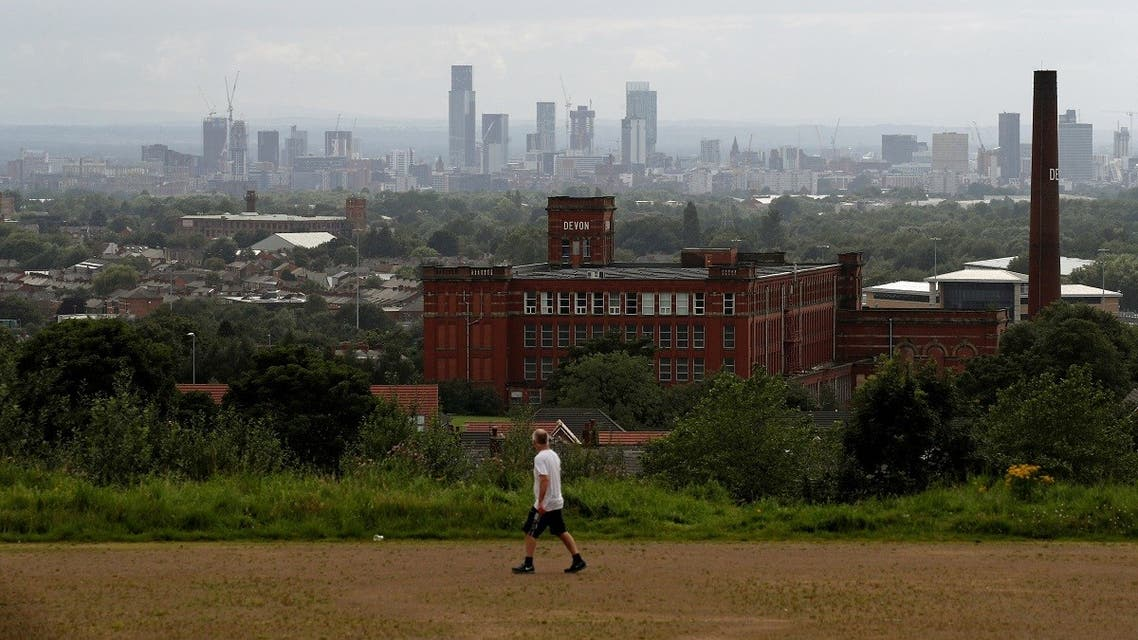 The skyline of Manchester is seen as a man exercises, amid the spread of the coronavirus disease (COVID-19), in Oldham, Britain, August 1, 2020. (Reuters)