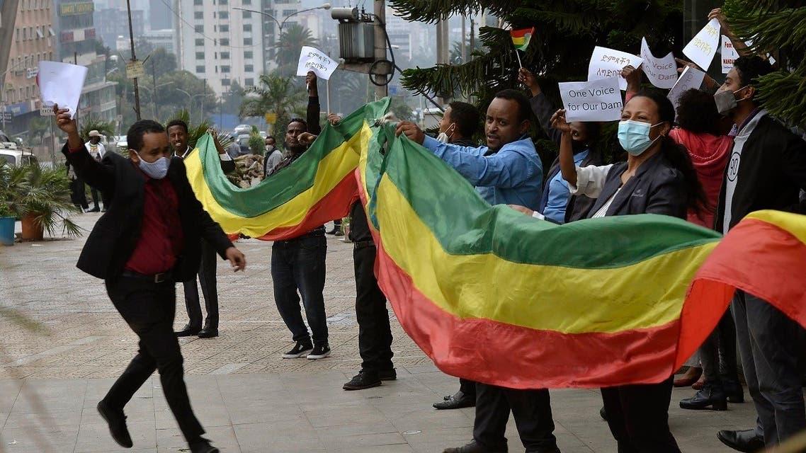Ethiopians celebrate the progress made on the Nile dam, in Addis Ababa, Ethiopia, Sunday August 2, 2020. (AP)