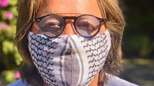 الكوفيّة الفلسطينيّة تنقلب قناعاً ضد كورونا في أميركا