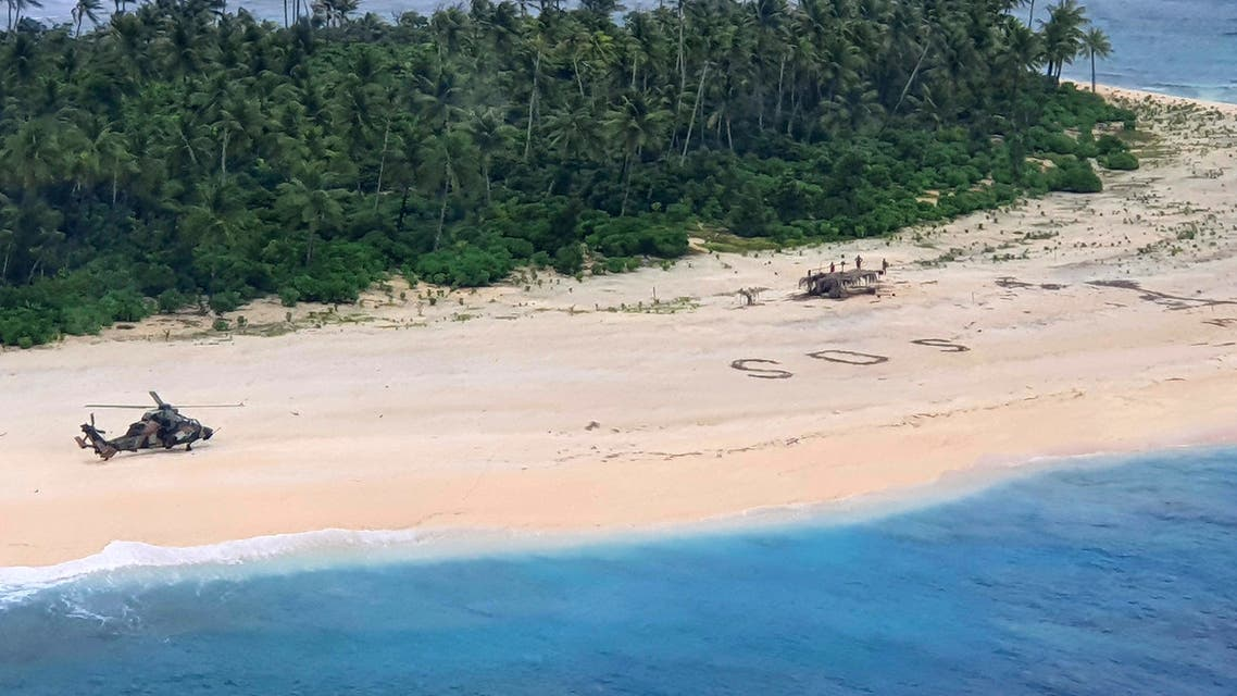 In this photo provided by the Australian Defence Force, an Australian Army helicopter lands on Pikelot Island in the Federated States of Micronesia, where three men were found, Sunday, Aug. 2, 2020, safe and healthy after missing for three days. (AP)