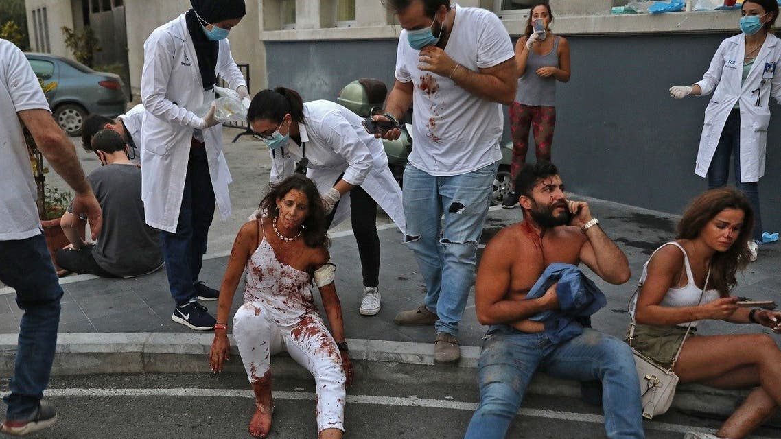 Wounded people are pictured outside a hospital following an explosion in the Lebanese capital Beirut on August 4, 2020. (AFP)