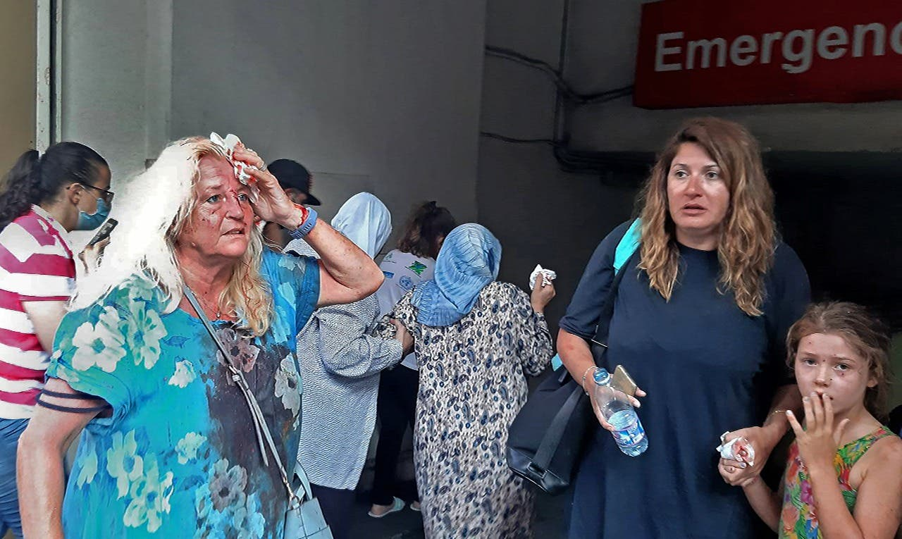 Valarie Fakhoury, a British grandmother with her Lebanese daughter and granddaughter, stand outside the emergency ward of a hospital in the Hamra district of central Beirut. (AFP)