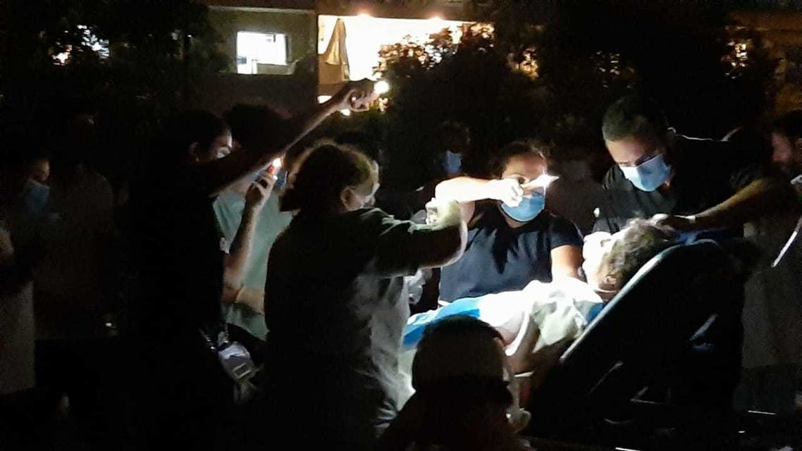 Nurses and doctors treat patients at the Saint George Hospital University Medical Center in a parking lot, Aug. 4, 2020. (Supplied)