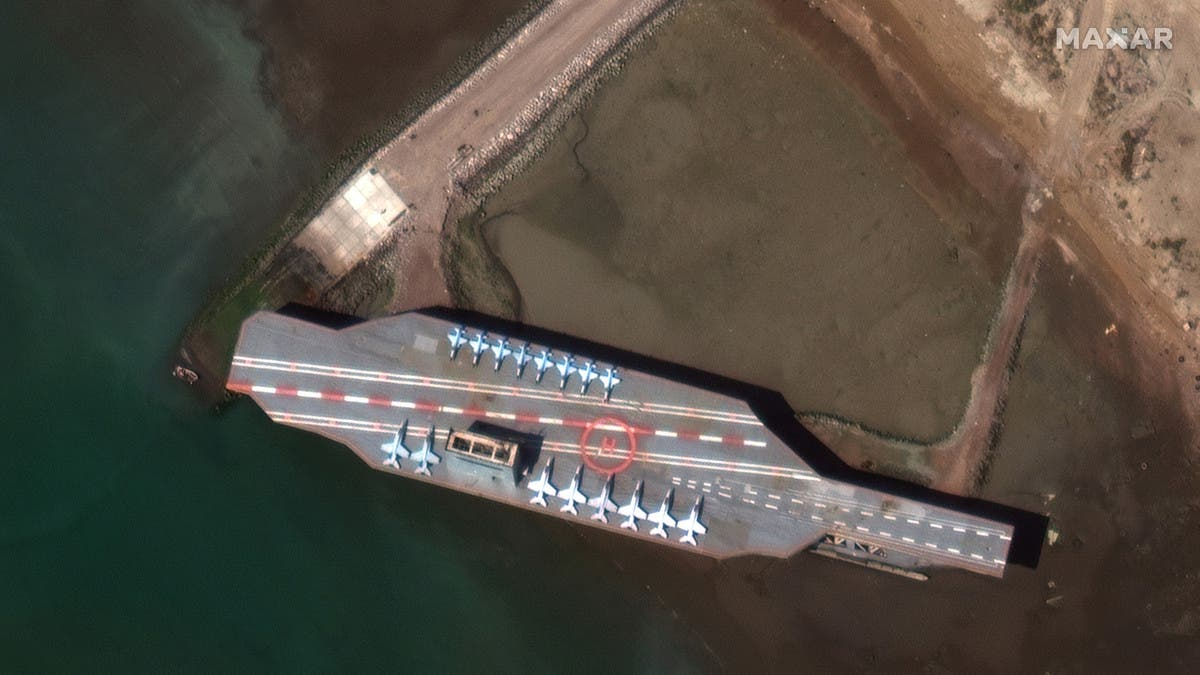 Mock-up US aircraft carrier sinks during Iran's war games, endangering passing ships thumbnail