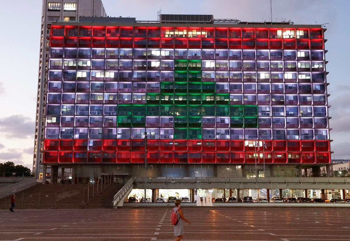 The city hall in the Israeli coastal city of Tel Aviv is lit up in the colours of the Lebanese national flag in solidarity, on August 5, 2020, a day after a devastating blast at the port of Lebanese's capital, in Israel's latest gesture towards a country with which it is technically at war. (AFP)