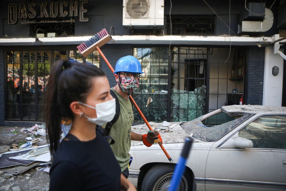 Lebanese activists take part in a campaign to clean the damaged neighborhood of Mar Mikhael on August 5, 2020. (AFP)