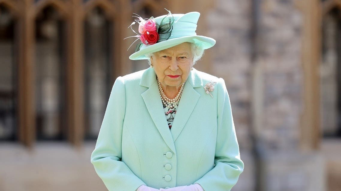 Britain's Queen Elizabeth II poses after confering the honour of a knighthood upon 100-year-old veteran Captain Tom Moore during an investiture at Windsor Castle in Windsor, west of London on July 17, 2020. (AFP)
