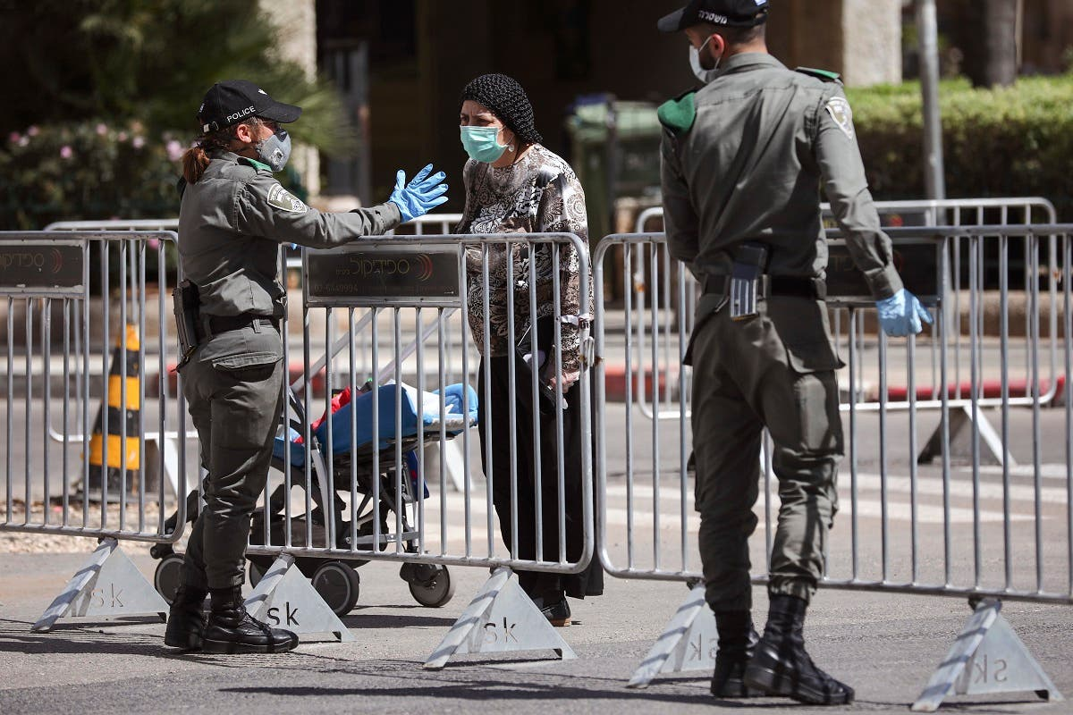 In this April 3, 2020 file photo, Israeli police officers block a main road following the spread of the coronavirus, in Bnei Brak, a suburb of Tel Aviv, Israel. (AP)