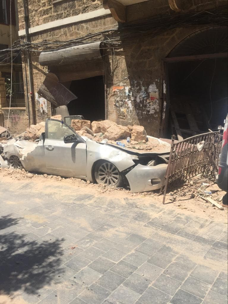 A car covered in rubble in Gemmayze, Beirut, after the blast in the port. (Supplied)